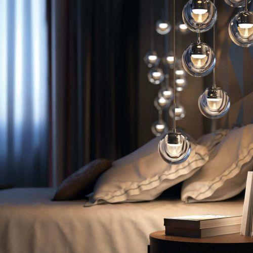 Kundalini | Dew 7 | Schlafzimmer mit Büchern auf Nachttisch | Leuchten Lukassen Lichtdesign